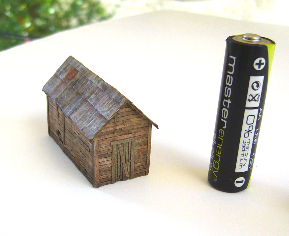 Creating a realistic wooden hut with paper